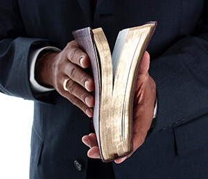 Bible in hand